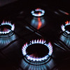 Rings of fire: four lighted gas stove burners.