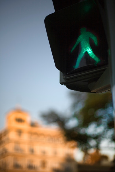 Pedestrian sign on a traffic light, Seville, Spain