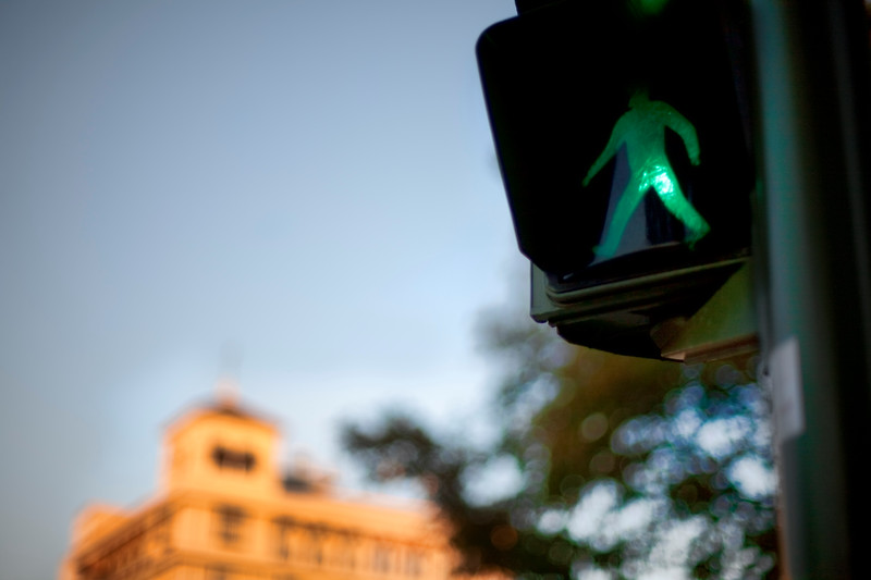 Pedestrian sign on a traffic light, Seville, Spain