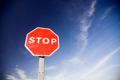 Stop sign in front of a deep blue sky, Spain