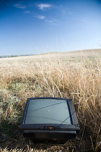 TV receiver thrown on a wheat field on the countryside, Spain