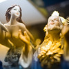 Figurines of Jesus Christ and a nude marmaid on a shop window, Seville, Spain