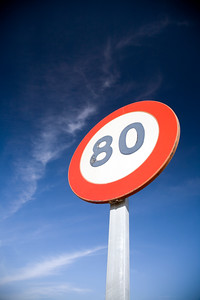Speed limit traffic sign in front of a deep blue sky, Spain