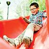 happy boy on red slide