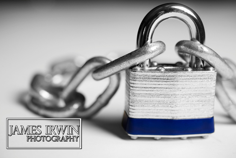 A product shoot of a lock with a change linked to it.  This emphasizes unity and things that go together.