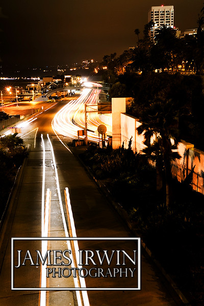night sceen of Santa Monica, CA capturing the motion of the cars on the highway using a long exposure