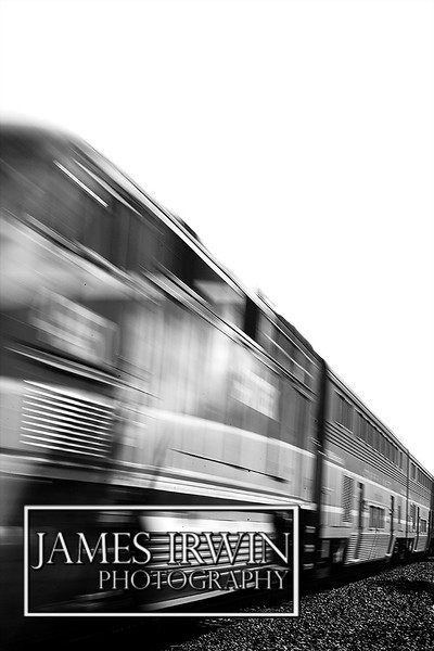 Capture the motion of the train going down the tracks.  The front of the train will show blurr.