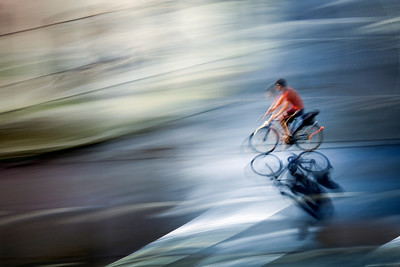 Panning shot of a cyclist by night, Berlin, Germany