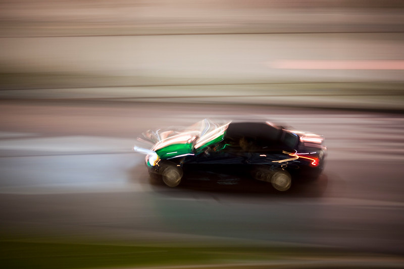 Panning shot of a car by night, Berlin, Germany