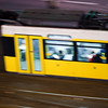 Panning shot of a tram by night, Berlin, Germany