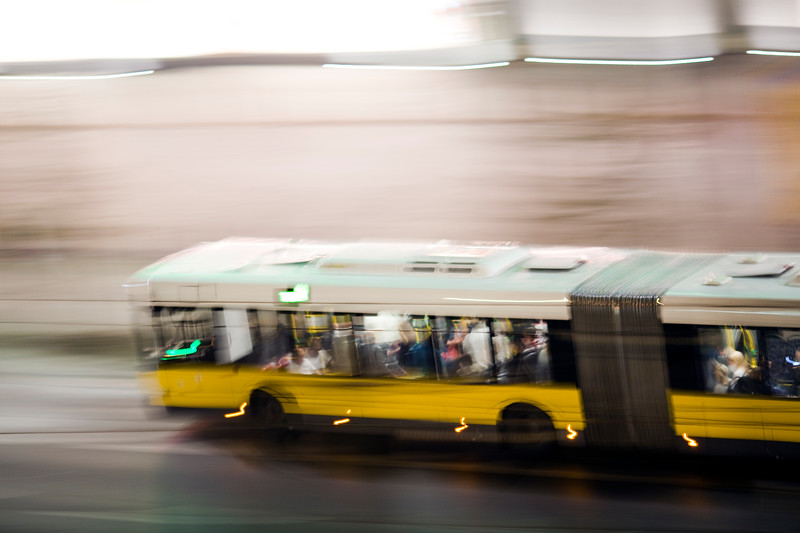 Panning shot of a bus by night, Berlin, Germany