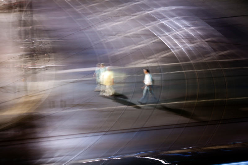 Panning shot of pedestrians crossing a road, Berlin, Germany