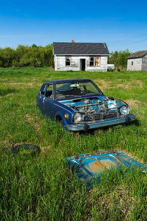 Blue Car and Weathered Home