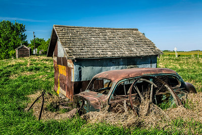 Rusty Car beside Shed