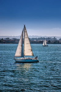 Sailboats on the blue waters