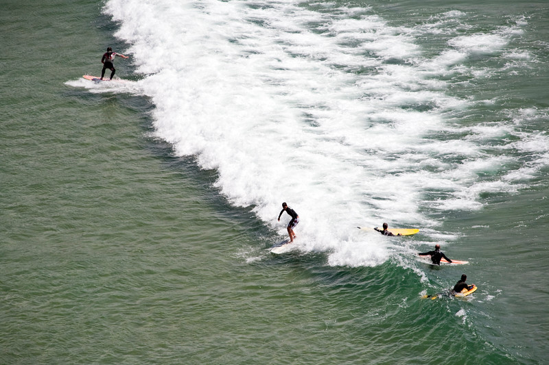 Surfers on Amoreira beach, town of Aljezur, district of Faro, region of Algarve, southwestern Portugal