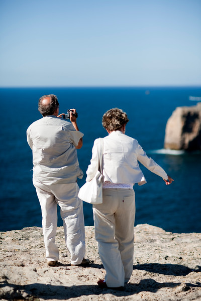 Senior couple looking at the Atlantic Ocean, cabo Sao Vicente (Cape Saint Vincent), town of Sagres, municipality of Vila do Bispo, district of Faro, region of Algarve, southwestern Portugal