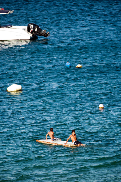 Children playing on a raft in the seaport, town of Sagres, municipality of Vila do Bispo, district of Faro, region of Algarve, southwestern Portugal