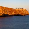 Mareta beach cliff at sunset, town of Sagres, municipality of Vila do Bispo, district of Faro, region of Algarve, southwestern Portugal