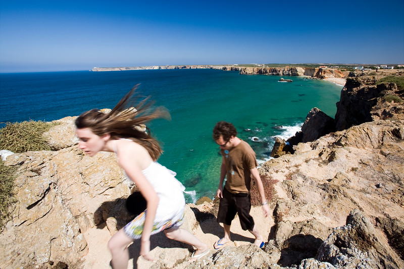 Young couple on the top of a cliff, town of Sagres, municipality of Vila do Bispo, district of Faro, region of Algarve, southwestern Portugal