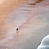 Surfer, Amoreira beach, town of Aljezur, district of Faro, region of Algarve, southwestern Portugal