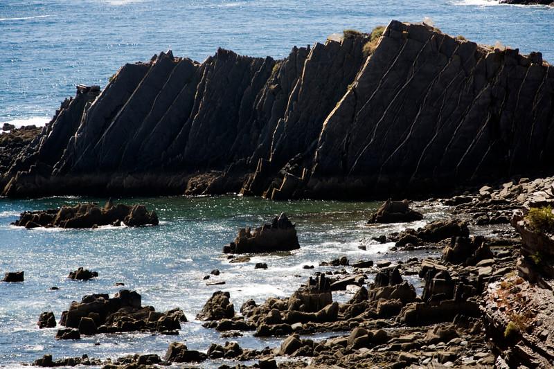 Geological strata near Amoreira beach, town of Aljezur, district of Faro, region of Algarve, southwestern Portugal