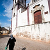 Old woman in front of Misericordia church, town of Silves, district of Faro, region of Algarve, Portugal