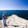 Man looking at the Atlantic Ocean, cabo Sao Vicente (Cape Saint Vincent), town of Sagres, municipality of Vila do Bispo, district of Faro, region of Algarve, southwestern Portugal