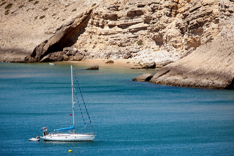 Sailing boat on Mareta bay, Atlantic Ocean. Town of Sagres, municipality of Vila do Bispo, district of Faro, region of Algarve, southwestern Portugal