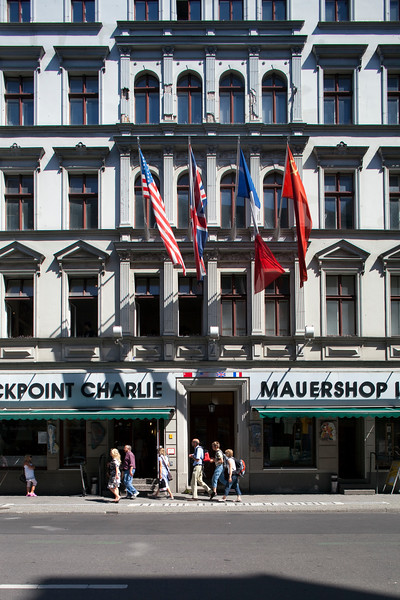 The World War II Allies flags on the facade of the Haus am Checkpoint Charlie Museum, Friedrichstrasse, Berlin, Germany