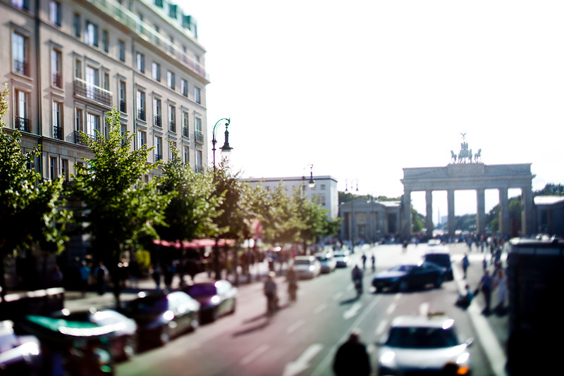 Brandenburg Gate from Unter den Linden street, Berlin, Germany. Tilted lens used for shallow depth of field.
