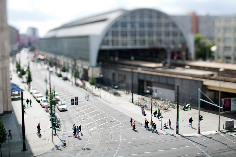 Walkers in front of Alexanderplatz station, Berlin, Germany. Tilted lens used for shallow depth of field.