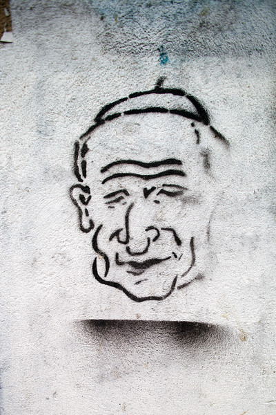 Stencil print caricature of the pope John Paul II on a wall, Berlin, Germany