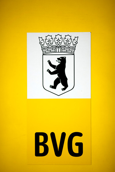 Coat of arms of the city and the acronym BVG (Berliner Verkehrsbetriebe), the public transportation company of Berlin, on the yellow bodywork of a tram, Berlin, Germany