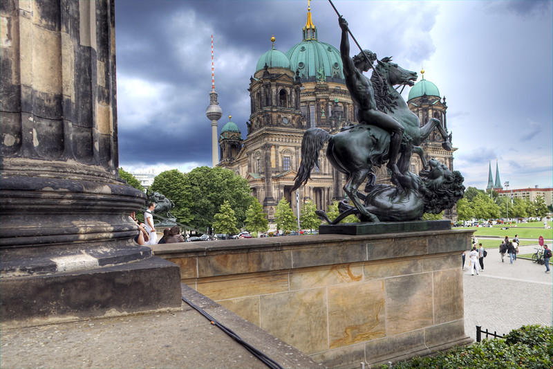 Facade of the Berliner Dom (Cathedral), with the TV Tower on the background, as seen from the Altes Museum portico, Berlin, Germany