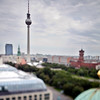 View of the Television Tower from the dome of the Cathedral, Berlin, Germany. Tilted lens used for shallow depth of field, selective focus on the tower.