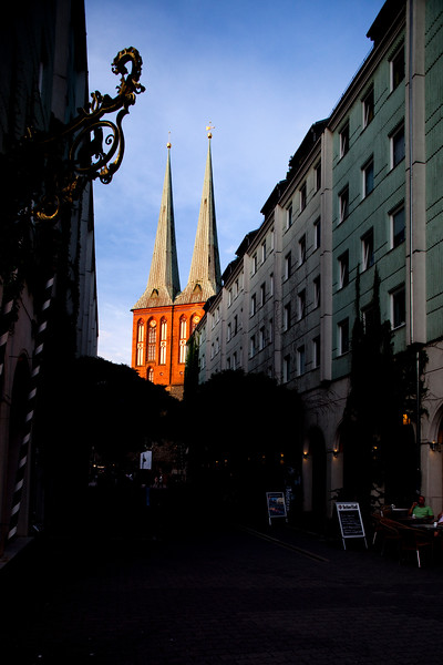Nikolaikirche (Saint Nicholas church) at the end of a street, Berlin, Germany