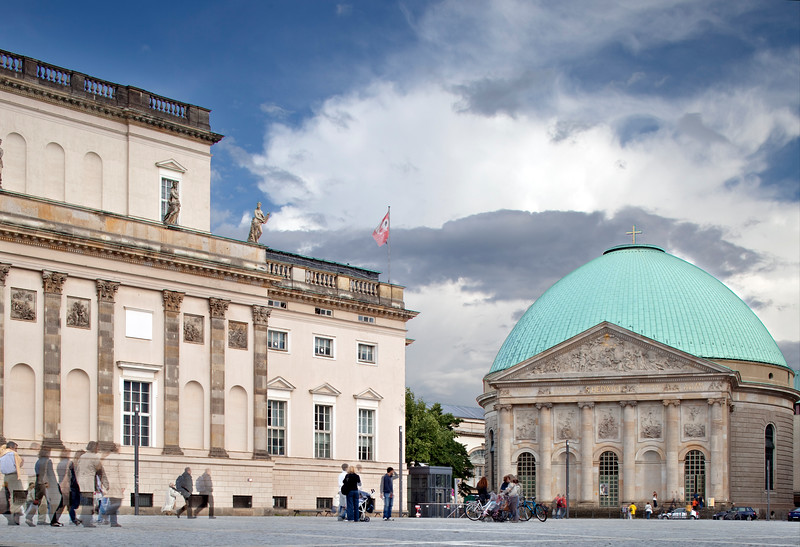 Staatsoper (left) and Saint Hedwig Catholic Cathedral (right) buildings on Bebelplatz, Berlin, Germany