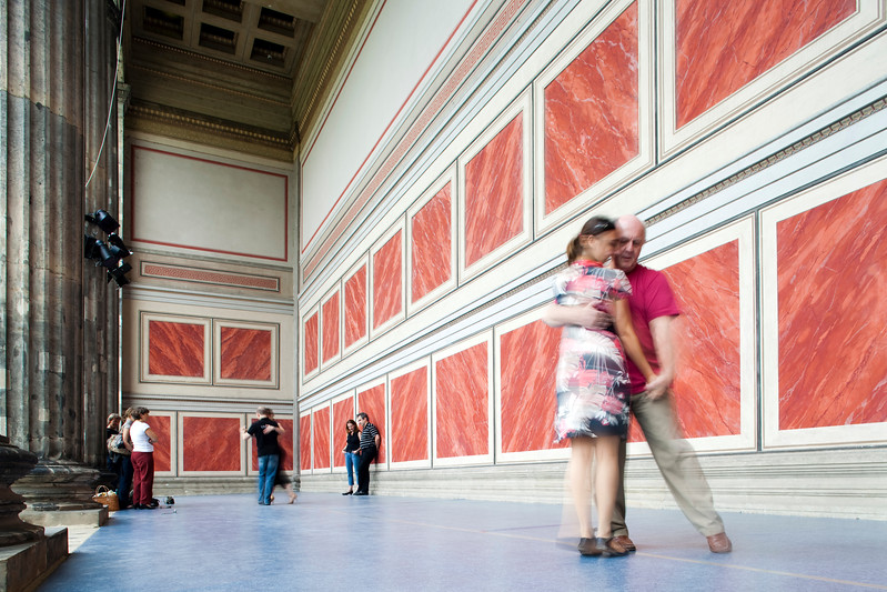 People dancing tango on the portico of the Altes Museum, Berlin, Germany