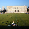 People sunbathing on Schlossplatz, Berlin, Germany. Tilted lens used for shallow depth of field.