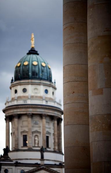 Konzerthaus columns and the German Cathedral (Deutsche Dom) on the background, Gendarmenmarkt square, Berlin, Germany
