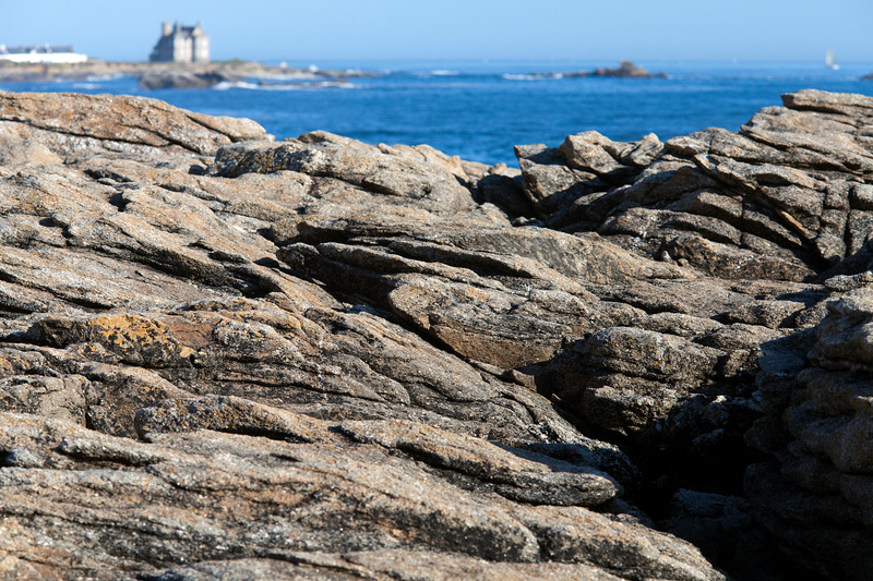 Cote Sauvage rocks with Turpault Mansion on the bacground, Quiberon, departament de Morbihan, Brittany, France