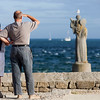 Couple looking at the sea, Kerpenhir point, town of Locmariaquer, departament of Morbihan, Brittany, France