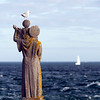 Statue on the sea, Kerpenhir point, town of Locmariaquer, departament of Morbihan, Brittany, France