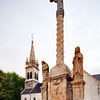Calvary and church of St Laurent and St Aubin, Brandivy, departement of Morbihan, Bretagne, France
