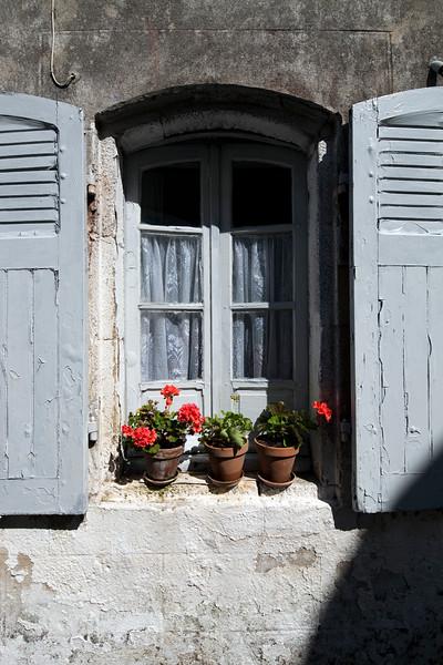 Flowerpots on a window, town of Baden, departament of Morbihan, Brittany, France