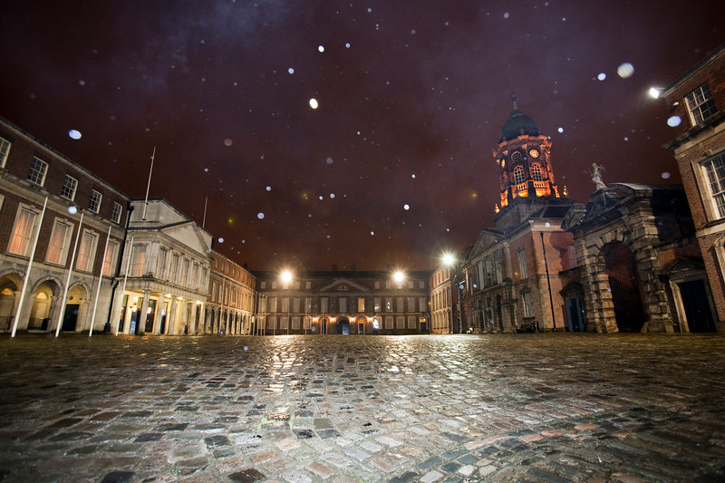 Snowing at Dublin Castle courtyard. The State Apartments (left) and the Bedford Hall and Tower(right) can be seen. Dublin, Ireland.