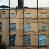 Traditional houses reflected on a modern glass building, Dublin, Ireland