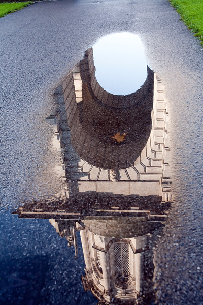 The Parliament Square Campanile reflected on a rain puddle, Trinity College, Dublin, Ireland