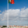 The Portuguese flag fluttering on the top of Saint George castle, Lisbon
